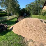 Egaliseren zandbaan | Betonplaten plaatsen | De Keij